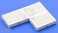 An adhesive backing secures the 170-point breadboard to your project.